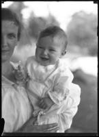 Informal portrait of an unidentified woman and baby, undated (ca. May 1918).