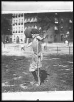 'Mickey the Cripple,' (a boy missing a foot) throwing a ball, New York City, April 24, 1919. Photographed for the Evangelistic Committee of New York City