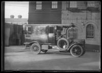 Motorized Bellevue Hospital ambulance, with unidentified driver, New York City, undated (ca. 1911-1922).