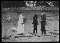 Ethel Grey Magaw Hassler and two unidentified men watching William Gray Hassler climb up a slope, New York City (?), undated (ca. 1912-1916).