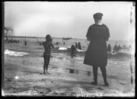 William Gray Hassler photographing his mother Ethel Magaw Hassler on Brighton Beach, New York City, undated (ca. 1912-1916).