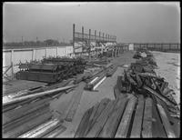 Unidentified construction site (Manhattan Beach?) beside the ocean, undated (ca. March 1917). Benches piled to one side.