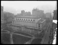 High-angle rear view of the main branch of the New York Public Library and the east end of Bryant Park, undated (ca. 1912). Some emulsion damage.