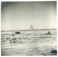 A military truck and a soldier in the desert