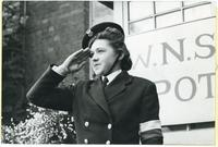 A portrait of saluting member of Women's Auxiliary Service