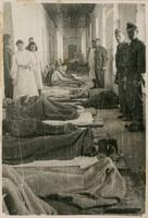 Corridor filled with patients in a hospital of the 7th Infantry Division