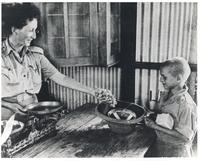 A Boy Receiving Grapes in Polish Camp in Tehran
