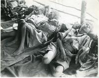 Children in Military Uniforms Lying on the Floor