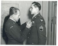 Colonel Karpinski Decorates an Airman
