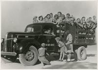 A Group of Polish Children in Uniform on an American Red Cross Truck in Tehran