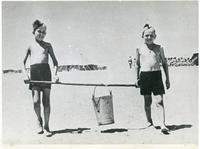 Two Boys Carrying a Bucket of Water in a Polish Camp in Tehran