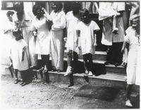 A Group of Children Standing on Hospital Stairs