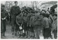 Group of Children Being Taken Care of by Soldiers