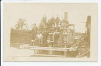 Men posing on docked paddle wheel boat (1front) [b0044ac1]