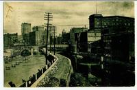 Canal flowing through industrial area, presumably Rochester (1front) [e0532ac1]