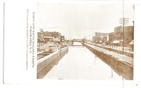 NORTH AND SOUTH NIAGARA STREETS. TONAWANDA. New York Erie Canal being enlarged to 1,000 ton barge capacity. [front caption printed in black ink] (1front) [e0703ac1]