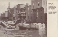 Break in Erie Canal letting water into Onondaga Creek, July 30, 1907. Five boats were destroyed and some buildings were damaged. Syracuse, N.Y. [front caption] (1front) [e0204ac1]