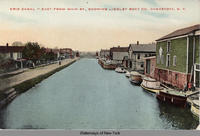 ERIE CANAL - EAST FROM MAIN ST., SHOWING LINDLEY BOAT CO., CANASTOTA, N.Y. [front caption] (1front) [e0158ac1]