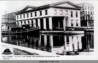 A D.O.T. TUG PASSES THE WEIGHTLOCK BUILDING, CA.1900: [front caption] (1front) [e0332ac1]
