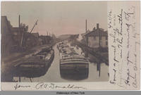 Three barges on the Oswego Canal; one barge is the PETER FLANIGAN [front caption] (1 front) [e0423ac1]