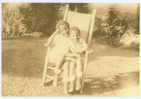 George and Margaret Peterson sitting on a chair together