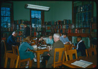 Crowded tables and readers in reference room