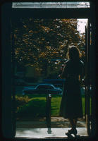 Young woman leaving the front door of the library