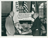 John Rosch displaying his History scrapbooks to Mayor Silas S. Clark
